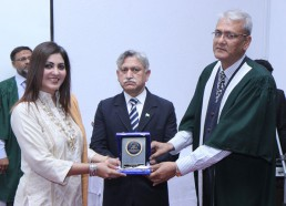 DHACSS Degree College - Huma Mir being presented with Momento